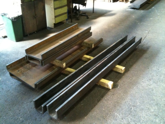New tender drag box sections (on the left) and  loco front buffer beam backing pieces (right) awaiting collection from Accurate  Section Benders.  These need further fabrication work, machining and  drilling before assembly.... more on that soon hopefully.