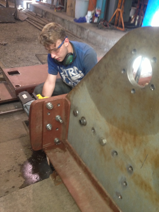 George drills holes in the tender frame top angle